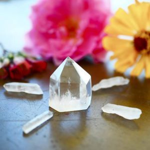 Clear Quartz crystal tower, carved crystal tower. Woman's hand holding clear quartz tower. Witchy decor, bohemian vibes. crystal healing, meditation crystals. Healing witch.Clear Quartz crystal tower,